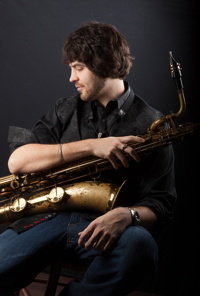 Photograph of Brian Landrus with baritone sax.