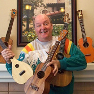 Photograph of instructor Doug Reynolds with several ukuleles.
