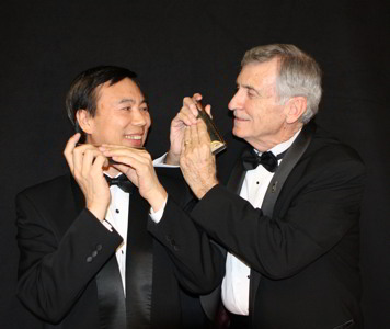 Photograph of harmonica players Jiayi He and Tom Stryker