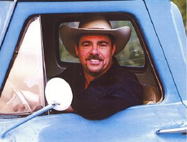 Photograph of Richard Elloyan in blue truck